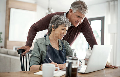 Buy stock photo Cropped shot of a mature couple using a laptop