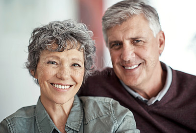 Buy stock photo Portrait of a loving mature couple relaxing at home