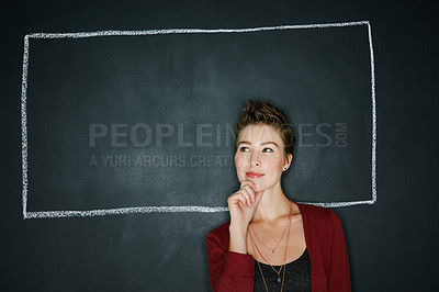 Buy stock photo Studio shot of a thoughtful young woman posing with a chalk illustration of a box against a dark background