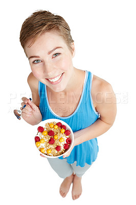 Buy stock photo Studio portrait of a young woman enjoying a muesli and yoghurt treat