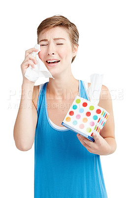 Buy stock photo Studio shot of a young woman wiping her tears