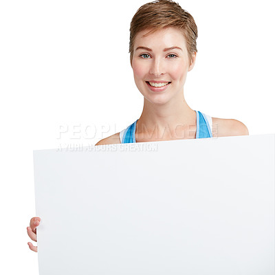 Buy stock photo Studio shot of an attractive young woman holding up a blank placard