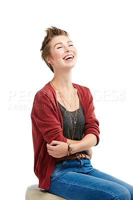 Buy stock photo Studio portrait of a joyful young woman sitting on a chair against a white background