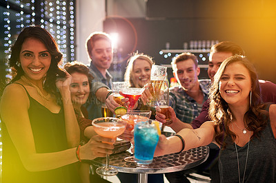Buy stock photo Portrait of a group of people toasting with their drinks at a nightclub