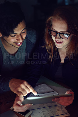 Buy stock photo Cropped shot of a group of young people working late in the office