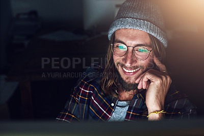 Buy stock photo Cropped shot of a designer working on his computer on a night shift at work