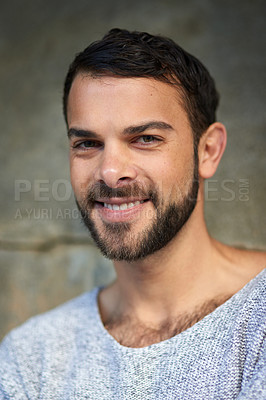 Buy stock photo Shot of a handsome young man posing outdoors