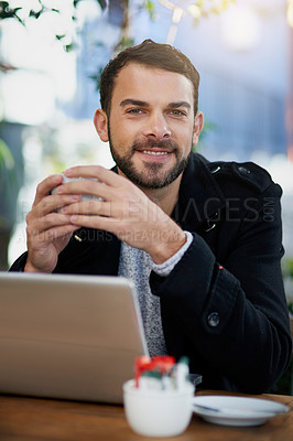 Buy stock photo Shot of a handsome young man enjoying a coffee break at an outdoor cafe