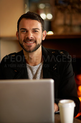 Buy stock photo Portrait of a handsome young man surfing the net in a coffee shop