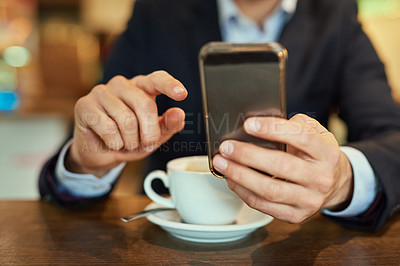 Buy stock photo Shot of an unrecognizable businessman sending a text message while sitting in a coffee shop