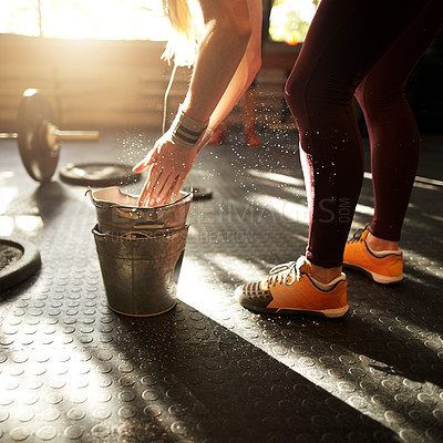 Buy stock photo Cropped shot of a woman dusting her hands with chalk at a gym