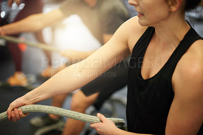 Buy stock photo Cropped shot of a woman working out with ropes at a gym