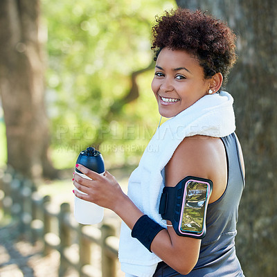 Buy stock photo Portrait of a sporty young woman out for a run