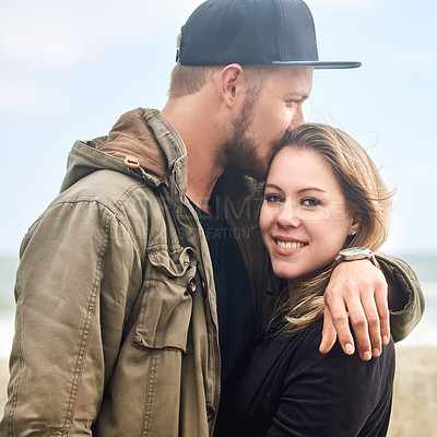 Buy stock photo Portrait of an affectionate young couple spending time together outdoors