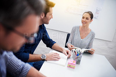 Buy stock photo Shot of a group of colleagues having a meeting in the boardroom
