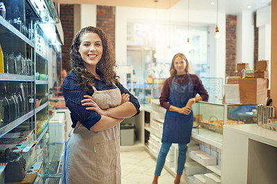 Buy stock photo Portrait of two young women standing in their cake shop