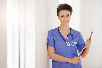 Buy stock photo Portrait of a young nurse holding a clipboard in a hospital