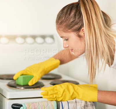 Buy stock photo Cropped shot of a young woman cleaning her kitchen at home