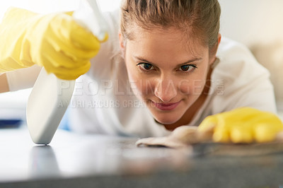 Buy stock photo Cropped shot of a young woman cleaning her home