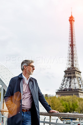 Buy stock photo Shot of a handsome mature man with the Eiffel Tower in the background