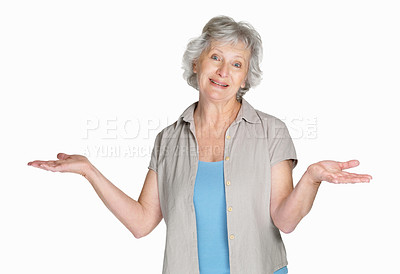 Buy stock photo Portrait of a happy mature woman shrugging her shoulder isolated against white