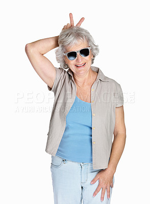 Buy stock photo Portrait of a naughty mature woman wearing sunglasses isolated against white