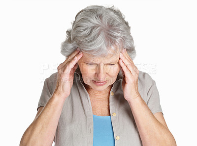 Buy stock photo Portrait of a sad senior female holding her head in pain isolated against white