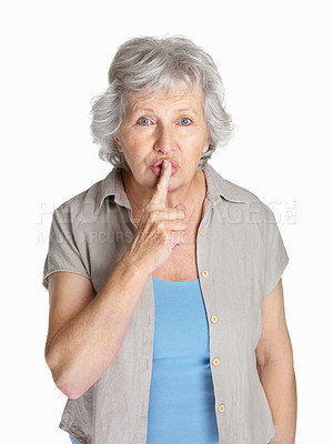 Buy stock photo Portrait of a mature woman making the gesture for quiet isolated against white