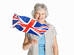 Happy female holding a flag of United Kingdom against white