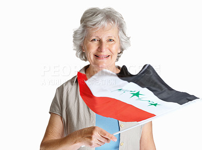 Buy stock photo Portrait of a happy senior female holding a Iraqi flag against white