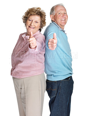 Buy stock photo Back to back - Happy senior couple showing a thumbs up sign isolated against white