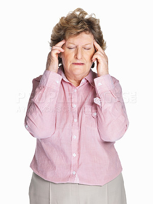 Buy stock photo Portrait of a sick elderly woman holding her head in pain isolated against white