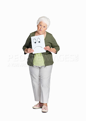 Buy stock photo Full length of a serious mature woman holding sheet of sad smiley isolated against white