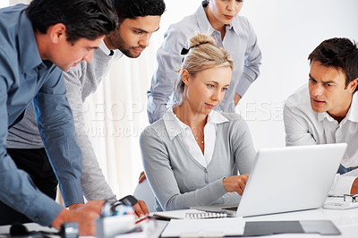 Buy stock photo Group of business people with their female leader looking at laptop in office