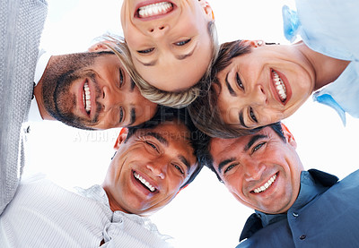 Buy stock photo Group of happy business people standing together in huddle