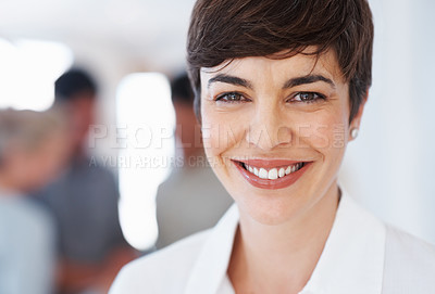 Buy stock photo Closeup of smiling business woman with blur team in background