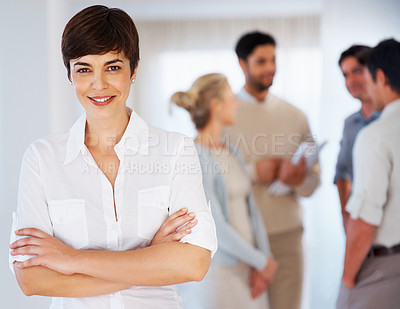 Buy stock photo Happy business woman with hands folded and team discussing in background