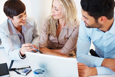 Buy stock photo Colleagues discussing project on laptop during business meeting