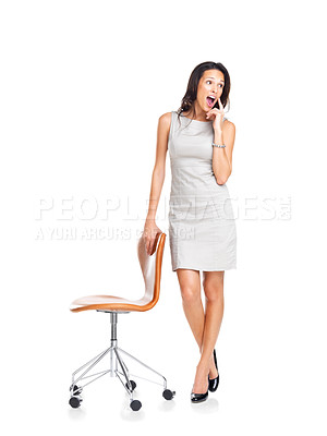 Buy stock photo Surprised young woman looking away at copyspace standing with a chair on white background