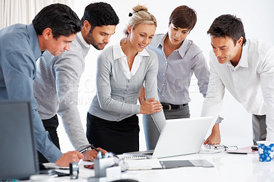Buy stock photo Female leader with her team looking at laptop during corporate meeting