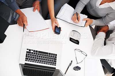 Buy stock photo High angle view of business people discussing work with laptop on table