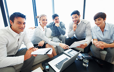 Buy stock photo Male leader discussing business project with his team with laptop and documents on table