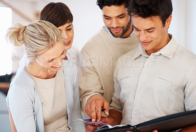 Buy stock photo Group of business people discussing together on project