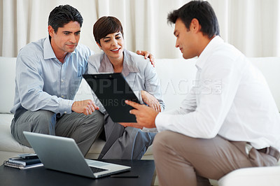 Buy stock photo Financial agent explaining contract details to couple