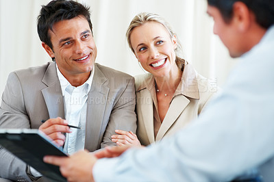 Buy stock photo Business couple in discussion with financial planner during meeting