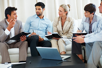 Buy stock photo Business man discussing project with colleagues during meeting