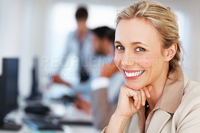 Buy stock photo Closeup of cute business woman with hand on chin and smiling with colleagues in blurred background