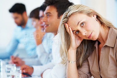 Buy stock photo Portrait of beautiful business woman sitting at table and looking at you with colleagues in background