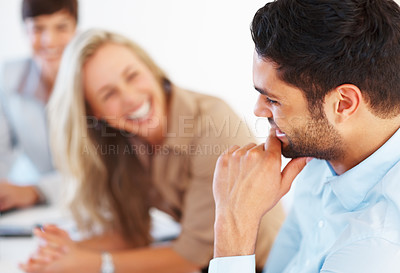 Buy stock photo Closeup of male executive smiling with colleagues sitting background
