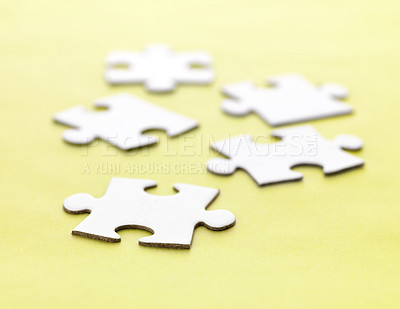 Buy stock photo Five jigsaw puzzle pieces on yellow background